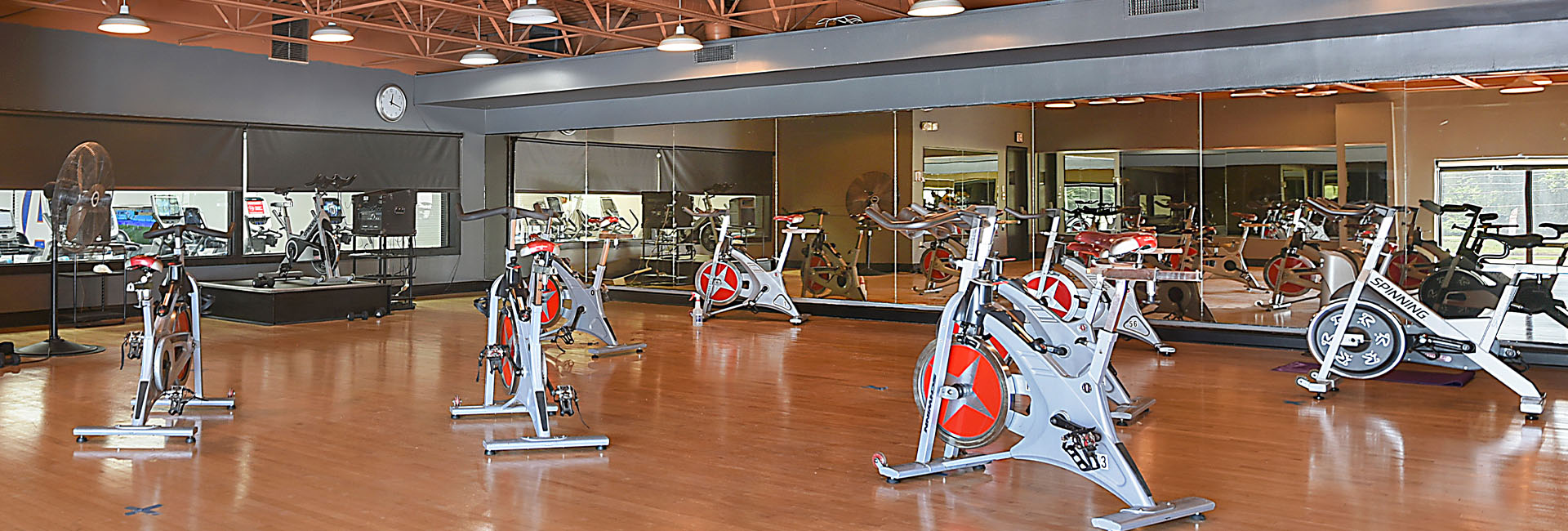 group fitness cycling room with spin bikes
