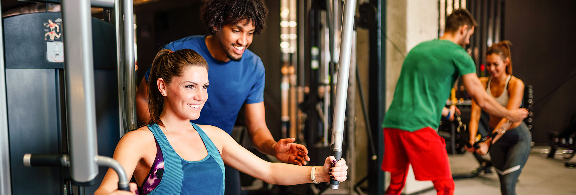 certified personal trainer working with a gym member