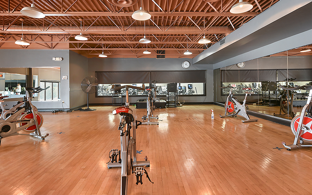 spin class room for group fitness cycling