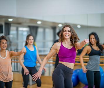 women dancing in a Zumba group fitness class
