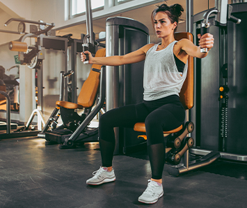 woman working out in a modern gym