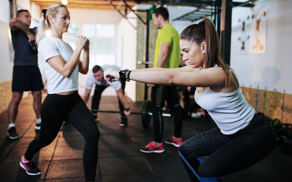 people working out together with a personal trainer