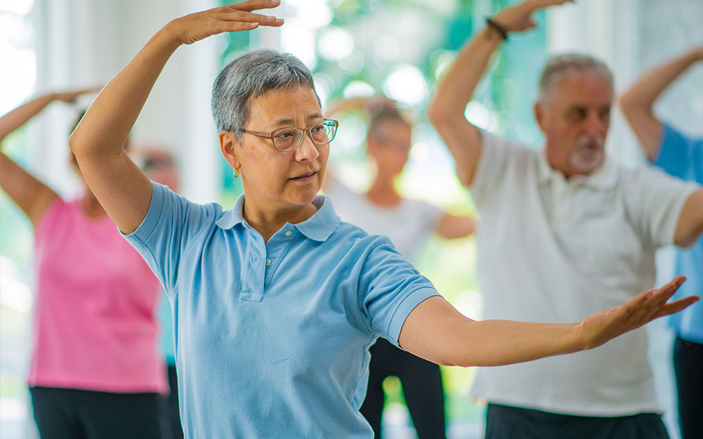 older gym members in a group fitness class